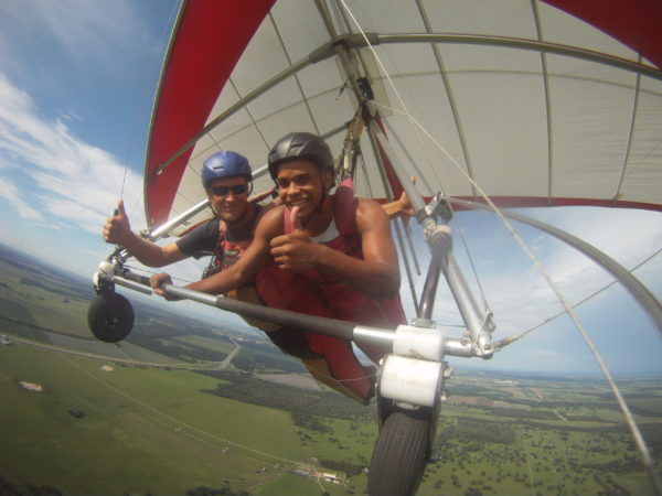 African American man flying tandem in a hang glider